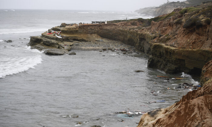 Wreckage and debris from a capsized boat washes ashore at Cabrillo National Monument near where a boat capsized just off the San Diego coast, Calif., on May 2, 2021. (Denis Poroy/AP Photo)