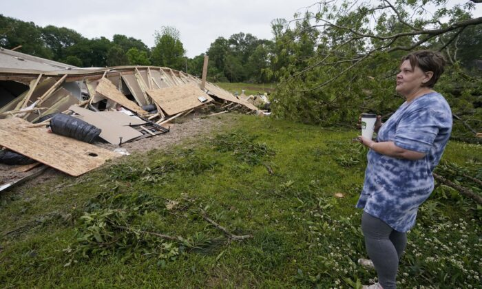 Vickie Savell looks at the remains of her new mobile home early in Yazoo County, Miss., on May 3, 2021. (Rogelio V. Solis/AP Photo)