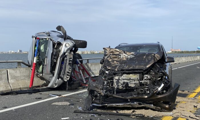The wreckage from a car accident on the Route 90 bridge in Ocean City, Md., on May 2, 2021. (Ocean City Fire Department via AP)