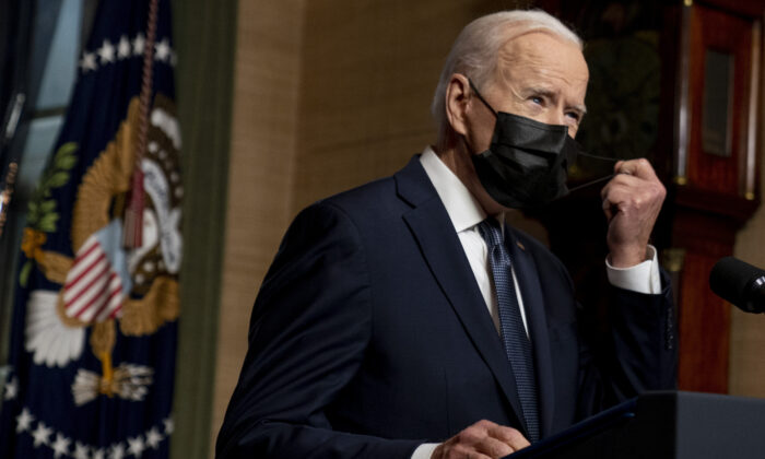 President Joe Biden removes his mask to speak at a news conference at the White House in Washington on April 14, 2021. (Andrew Harnik, Pool, File/AP Photo)