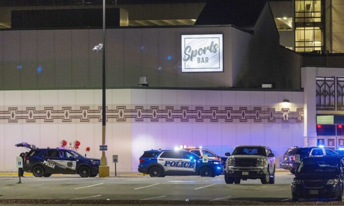 Police line the parking lot outside the Oneida Casino in the early morning hours of Sunday, May 2nd, 2021, near Green Bay, Wisconsin. (AP Photo/Mike Roemer)