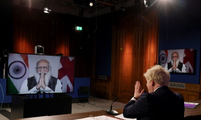 British Prime Minister Boris Johnson and his Indian counterpart Narendra Modi greet each other during a virtual meeting on May 4, 2021. (UK Prime Minister's Office)