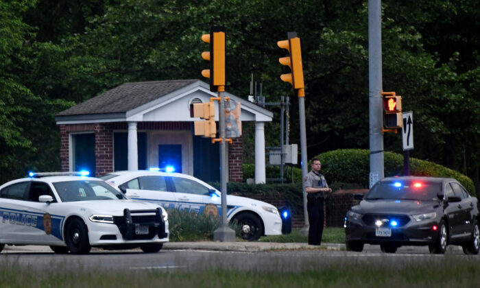 Police cars are seen outside the CIA headquarters's gate after an attempted intrusion earlier in the day in Langley, Va., on May 3, 2021. (Olivier Douliery/AFP via Getty Images)