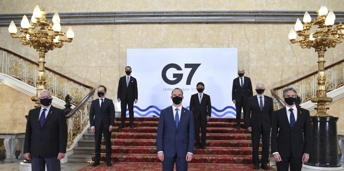 G7 foreign ministers wear face masks and are socially distanced for a group photo