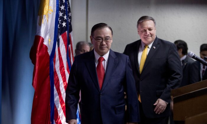 Philippines' Foreign Secretary Teodoro Locsin Jr. (L) and U.S. Secretary of State Mike Pompeo (R) arrive for a news conference at the Philippines Department of Foreign Affairs Home Office in Manila on March 1, 2019. (Andrew Harnik/AFP via Getty Images)
