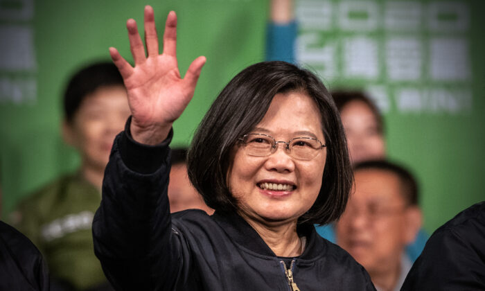 Taiwan President Tsai Ing-Wen waves after addressing supporters following her re-election as President of Taiwan in Taipei, Taiwan, on Jan. 11, 2020. (Carl Court/Getty Images)