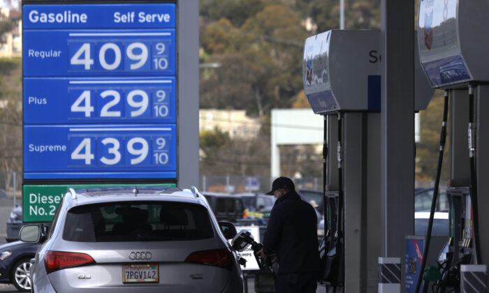 A customer pumps gas into his vehicle at a Chevron gas station in Mill Valley, Calif., on March 3, 2021.  (Justin Sullivan/Getty Images)