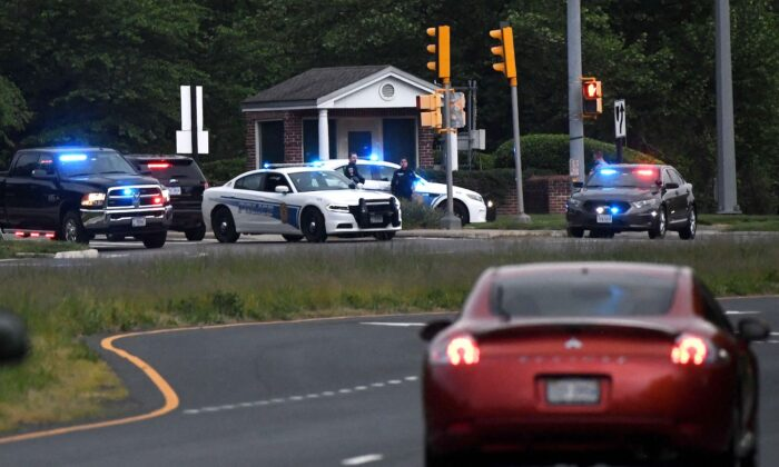 Police cars are seen outside the CIA headquarters's gate after an attempted intrusion earlier in the day in Langley, Virginia, on May 3, 2021. (Olivier Douliery/AFP via Getty Images)
