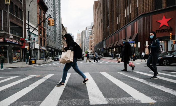 People walk through downtown Brooklyn in New York City on May 3, 2021. (Spencer Platt/Getty Images)