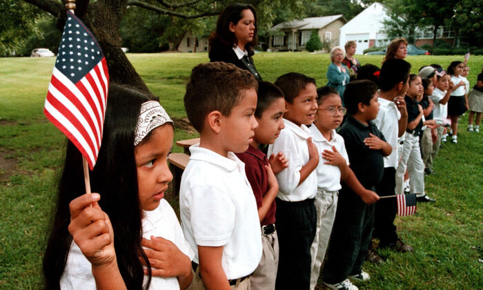 A class of Hispanic students recites the Pledge of Allegiance during a Sept. 11 memorial service at Birdwell Elementary School in Tyler, Texas. on Sep. 11, 2003. (Mario Villafuerte/Getty Images)