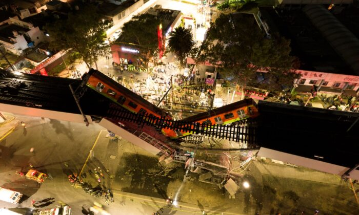 A general view of damage caused after a railway overpass and train collapsed onto a busy road in Mexico City, Mexico, on May 4, 2021. (Instagram@CSDRONES/via Reuters)