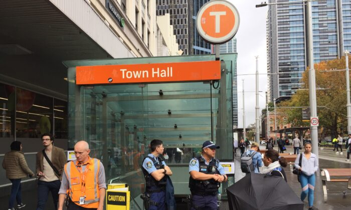 Police block off an entrance to Town Hall train station in Sydney, Wednesday, May 5, 2021. (AAP Image/Lloyd Jones)