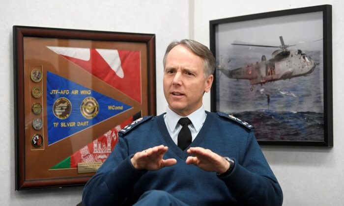 Commander of the Royal Canadian Air Force Al Meinzinger is seen during an interview with The Canadian Press in his office at National Defence headquarters in Ottawa on Dec. 12, 2019. (Adrian Wyld/The Canadian Press)