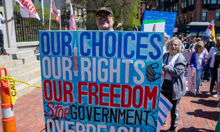 People marched for lifting more restrictions,especially removing the requirement to wear masks on May 1, 2021, in Boston, Mass. (Learner Liu/Epoch Times)