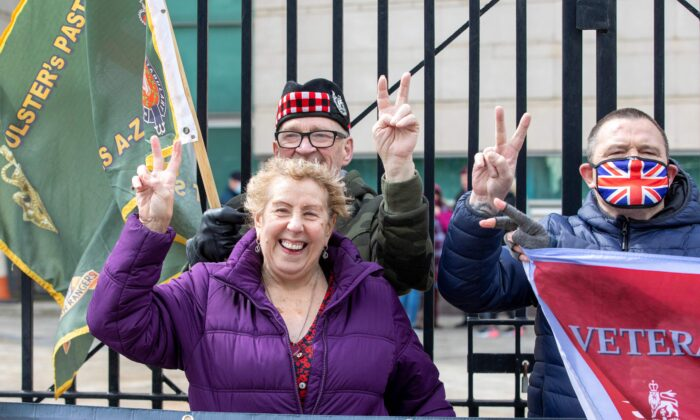 Supporters of Soldier A and Soldier C react after the case against the two former paratroopers collapsed at the High Court in Belfast on May 4, 2021. (Paul Faith/AFP via Getty Images)