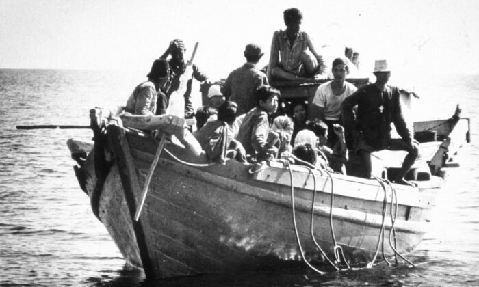 Circa 1975:  Refugees from southeast Asia, known as boat people, arriving in the USA.  (MPI/Getty Images)
