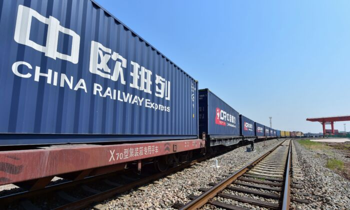 A freight train transporting containers laden with goods from London, arrives at Yiwu railway port station in Yiwu, east China's Zhejiang Province on April 29, 2017. (STR/AFP via Getty Images)