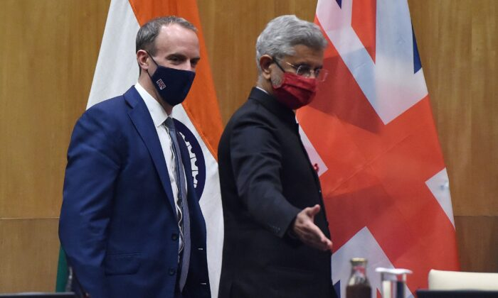 India's Foreign Minister Subrahmanyam Jaishankar (R) gestures to UK Foreign Secretary Dominic Raab as they arrive for a press interaction following their 'India-UK Ministerial Dialogue' meeting in New Delhi on Dec. 15, 2020. (Money Sharma/AFP via Getty Images)