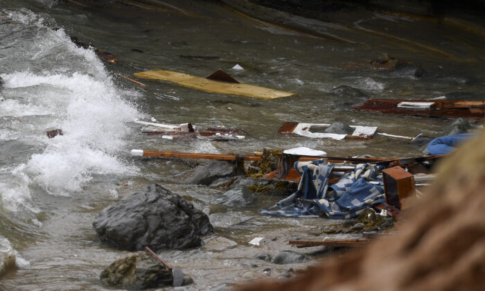 Wreckage and debris from a capsized boat washes ashore at Cabrillo National Monument near where a boat capsized just off the San Diego coast, in San Diego, Calif., on May 2, 2021. (Denis Poroy/AP Photo)