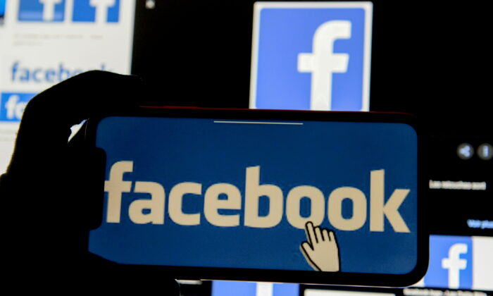The Facebook logo is displayed on a mobile phone in this picture illustration taken on Dec. 2, 2019. (Johanna Geron/Illustration/Reuters)