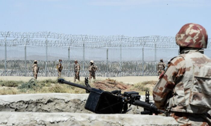 Security personnel of Pakistan's Frontier Corps patrol near the newly inaugurated BadiniTradeTerminal Gateway, a border crossing point between Pakistan and Afghanistan at the Pakistan's border town of Qila Saifullah in the southwestern province of Balochistan, on Sept. 16, 2020. (Banaras Khan/AFP via Getty Images)