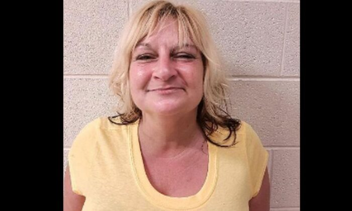 Authorities in Maryland arrested a woman who they said set fire to her home with someone inside and was apparently captured on video sitting in a lawn chair while it went up in flames. (Maryland State Fire Marshall)