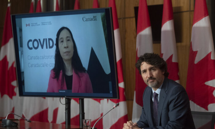 Chief Public Health Officer Theresa Tam appears via video conference as Prime Minister Justin Trudeau attends a news conference in Ottawa, Canada, on May 4, 2021. (Adrian Wyld/The Canadian Press)