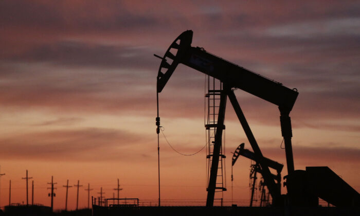 ANDREWS, TX - JANUARY 20:  An oil pumpjack works at dawn in the Permian Basin oil field on January 20, 2016 in the oil town of Andrews, Texas. Despite recent drops in the price of oil, many residents of Andrews, and similar towns across the Permian, are trying to take the long view and stay optimistic. The Dow Jones industrial average plunged 540 points on Wednesday after crude oil plummeted another 7% and crashed below $27 a barrel.  (Photo by Spencer Platt/Getty Images)