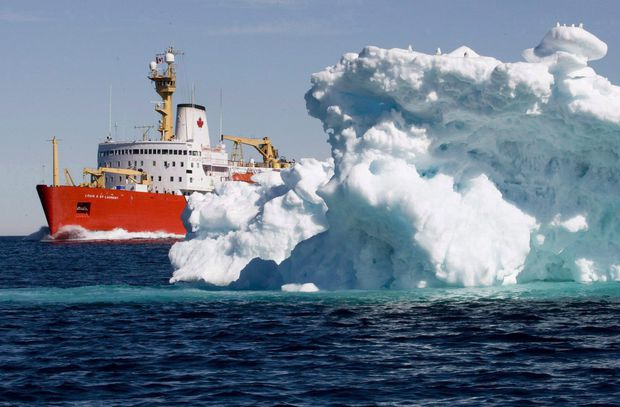 The Canadian Coast Guard icebreaker Louis S. St-Laurent sails past an iceberg in Lancaster Sound, on July 11, 2008. (Jonathan Hayward/The Canadian Press)
