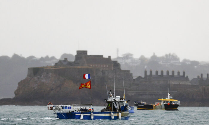French fishing boats protest in front of the port of Saint Helier off the British island of Jersey to draw attention to what they see as unfair restrictions on their ability to fish in UK waters after Brexit, on May 6, 2021. (Sameer Al-Doumy/AFP via Getty Images)