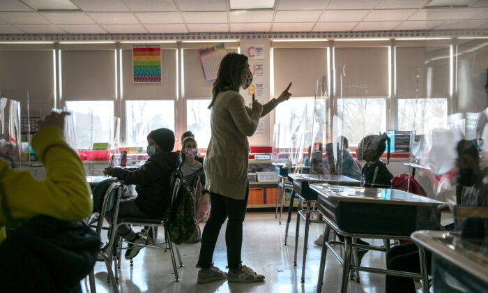 A teacher is seen in a classroom in a file photo. (John Moore/Getty Images)