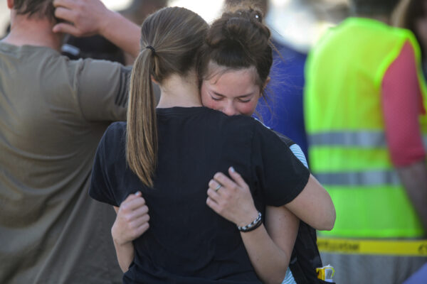 Students embrace after a school shooting