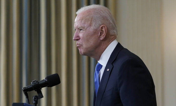 President Joe Biden takes questions from reporters in the State Dining Room of the White House in Washington on May 5, 2021. (Evan Vucci/AP Photo)