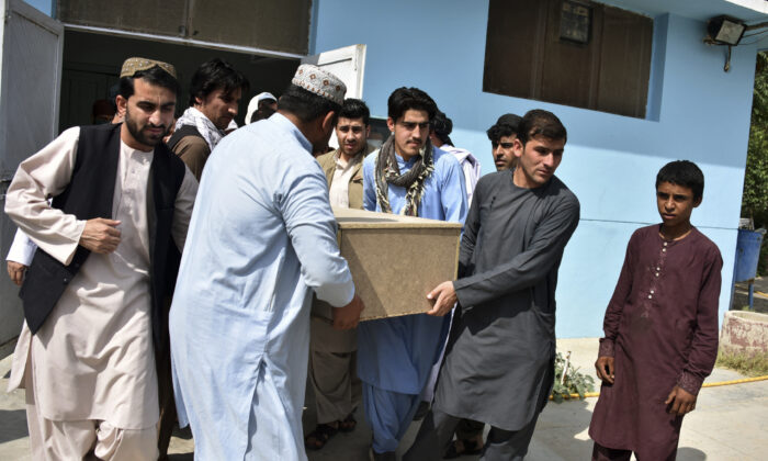 Relatives carry a coffin with the body of terlevion journalidst Nemat Rawan he was shot dead by gunmen, in Kandahar Province on May 6, 2021. (Javed Tanveer/AFP via Getty Images)