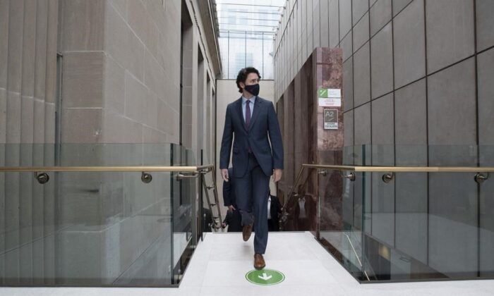 Prime Minister Justin Trudeau walks to a news conference in Ottawa on May 4, 2021. A broad coalition of MPs from all five parties wants the federal government to support waiving the global rules that guard vaccine trade secrets. (Adrian Wyld/The Canadian Press)