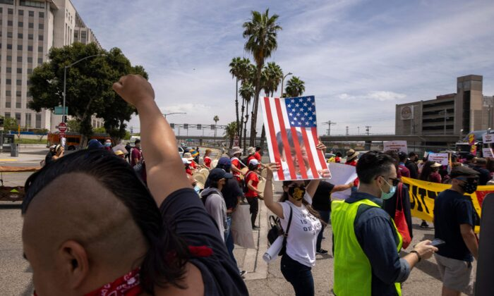 A coalition of activist groups and labor unions participate in a May Day march for workers' and human rights in Los Angeles, Calif., on May 1, 2021. (David McNew/AFP via Getty Images)