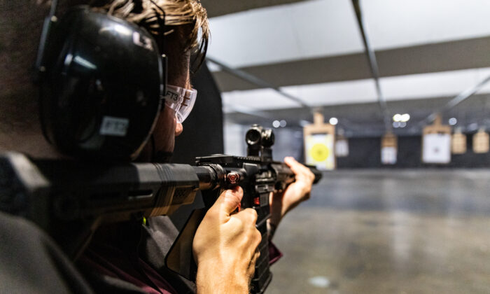 A man uses an AR-15 rifle at FT3 Tactical shooting range in Stanton, Calif., on May 3, 2021. (John Fredricks/The Epoch Times)