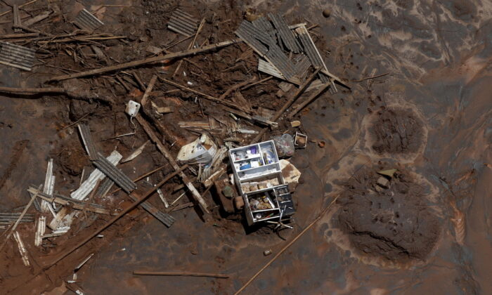 Debris in Bento Rodrigues district, which was covered with mud after a dam owned by Vale SA and BHP Billiton Ltd burst, in Mariana, Brazil, on Nov. 10, 2015. (Ricardo Moraes/Reuters)