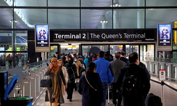 People queue to enter terminal 2, as tighter rules for international travellers start, at Heathrow Airport, amid the spread of the COVID-19 pandemic, London, Britain, Jan. 18, 2021. (Henry Nicholls/Reuters)