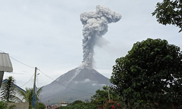 Mount Sinabung releases volcanic materials during an eruption in Karo, North Sumatra, Indonesia, on May 7, 2021. (Sastrawan Ginting/AP Photo)