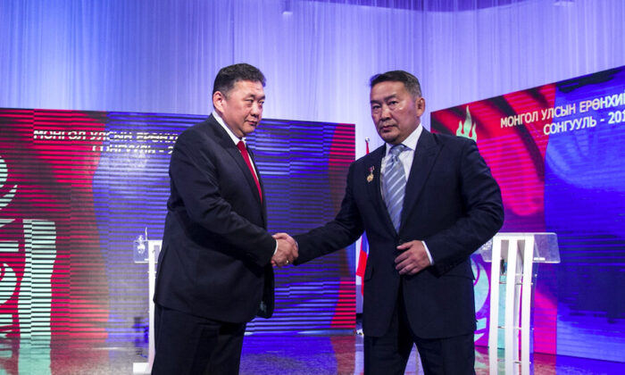 Mongolia's candidates for 2017 presidential election Enkhbold (L) and now-president Battulga (R) take part in a televised debate in Ulaanbaatar, Mongolia, on June 24, 2017. (Byambasuren Byamba-Ochir/AFP via Getty Images)