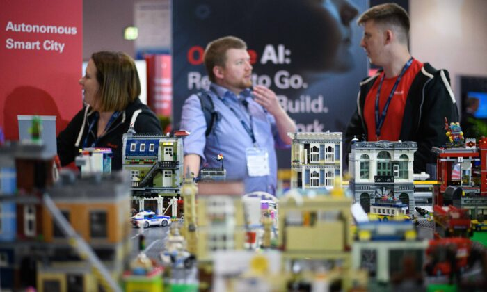 """A model of an autonomous """"Smart City"""" is seen on the Oracle display stand during the TechXLR8 event at ExCel in London on June 12, 2019. (Leon Neal/Getty Images)"""