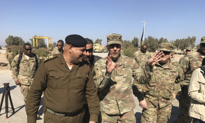 Then-Army Lt. Gen. Stephen Townsend talks with an Iraqi officer during a tour north of Baghdad, Iraq, on Feb. 8, 2017. (Ali Abdul Hassan/File/AP Photo)