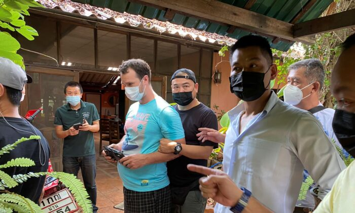 Police arrest and interrogate American citizen Jason Matthew Balzer, center, in Chiang Mai province northern Thailand before charging him for intentionally murdering his pregnant wife in Nan province, Thailand, on May 6, 2021 (Thai Provincial Police Region 5 via AP)