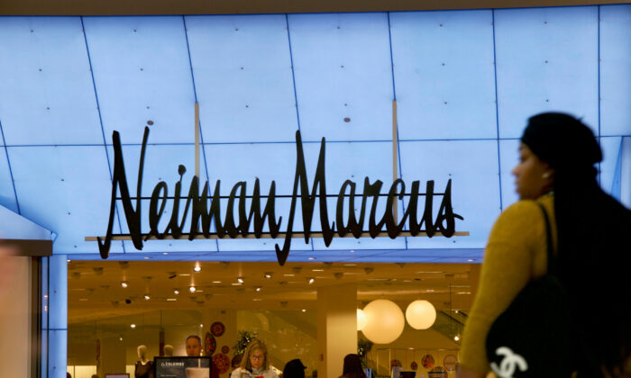Shoppers enter and exit the Neiman Marcus at the King of Prussia Mall, United States' largest retail shopping space, in King of Prussia, Pa., on Dec. 8, 2018.  (Mark Makela/Reuters)