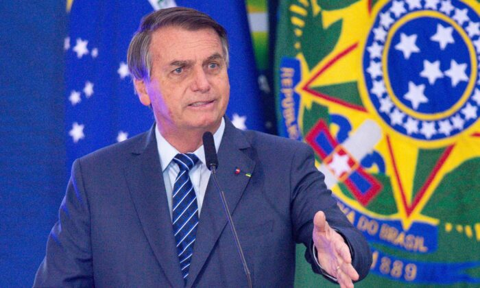 President of Brazil Jair Bolsonaro gives a speech during the opening of Brazil Communications week at Planalto Palace in Brasilia, Brazil, on May 5, 2021. (Andressa Anholete/Getty Images)