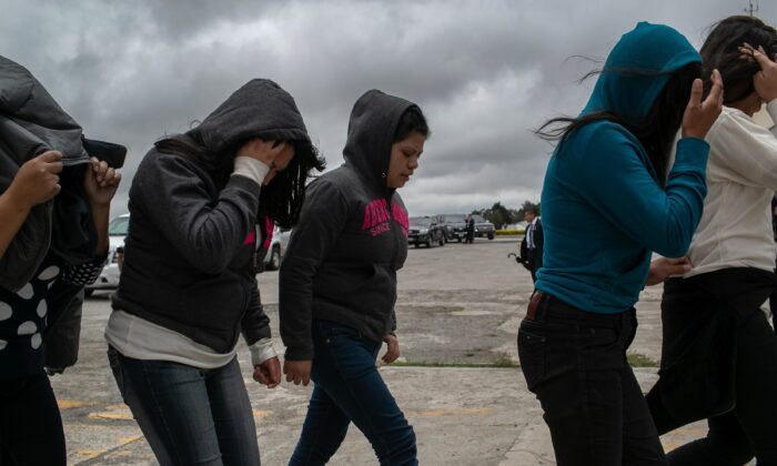 Women walk from the airport tarmac after being deported from the United States, in Guatemala City, Guatemala, on May 30, 2019. (John Moore/Getty Images)
