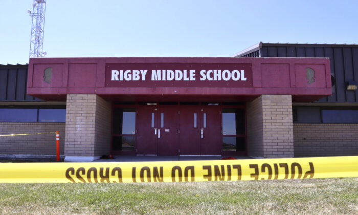 Police tape marks a line outside Rigby Middle School following a shooting there, in Rigby, Idaho, on May 6, 2021. (Natalie Behring/AP Photo)