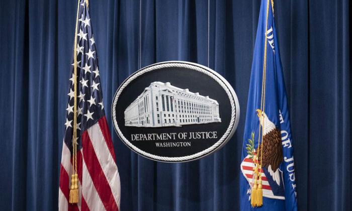 A sign for the Department of Justice is seen in Washington, on Jan. 12, 2021. (Sarah Silbiger-Pool/Getty Images)