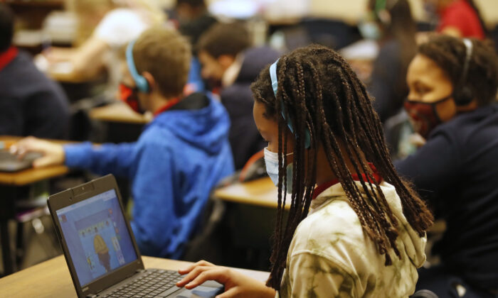 A school student works on a computer in Provo, Utah, on Feb. 10, 2021. (George Frey/Getty Images)